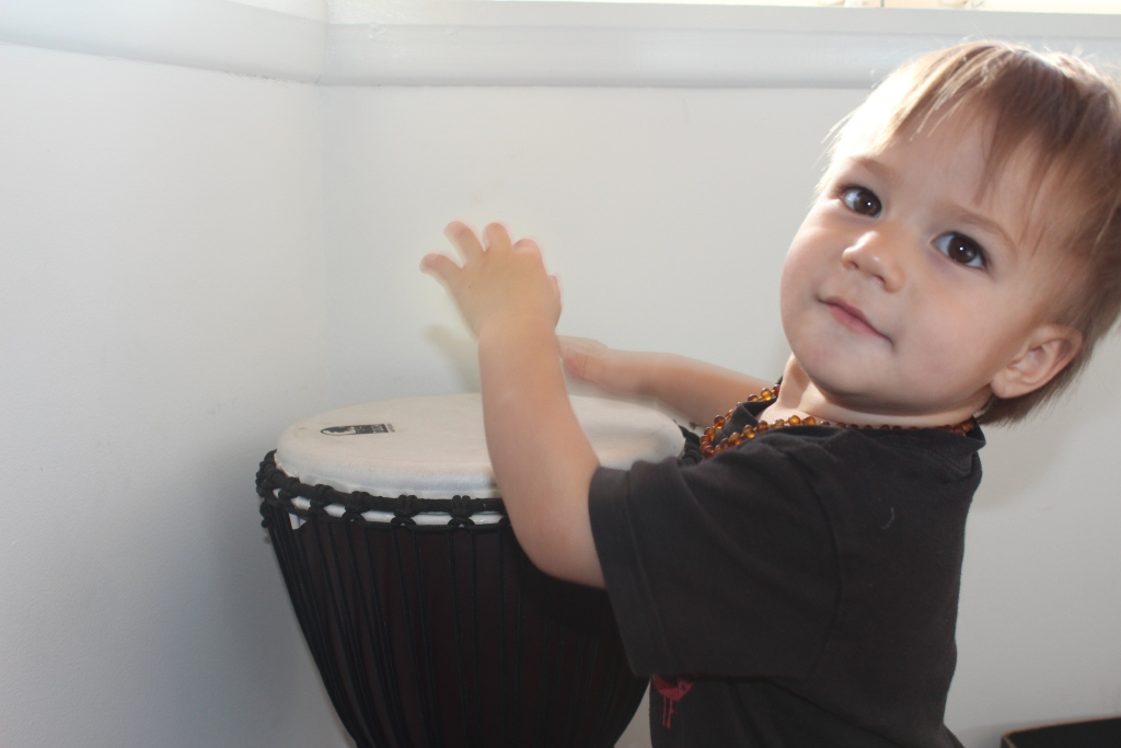 One year old Zavian playing the drums